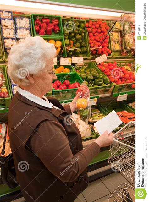 Senior When Shopping For Food In The Supermarket Royalty